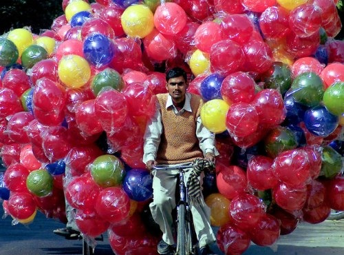 images_funny_man_riding_bicycle_with_balloons