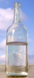 Transparent bottle of water against a cloudy sky